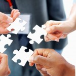business people solving puzzle